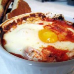 baked egg with goat cheese and tomato sauce